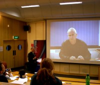 Nick Davies, author of Flat Earth News talks to the conference via video link. | Photo: Shane Croucher