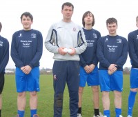 "Chris Sutton with the Galectico players holding two of the stress balls included in the ""ball bags"". Photo: Tom Farmery"