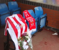 Tributes for former Lincoln City manager Keith Alexander can be left in the club's hoem dugout at Sincil Bank.