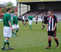 Two of the players look on, possibly a reflection of the season both Lincoln and Grimsby have had. Photo: Leila Fitt