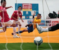 Brazil's Rafael scores at this summer's Homeless World Cup in Rio de Janeiro. Photo: Photographers for Hope