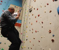 Sir Steve Redgrave tackles the climbing wall at The Showroom. Photo: Tom Farmery