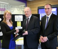 A student collects their Lincoln Award certificate from Pro Vice Chancellor Scott Davidson. Photo: Alex Colman