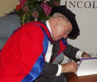 Doctor of Letters Colin Dexter OBE autographs a programme for one of the lecturers at the university. Photo: Jamie Freshwater
