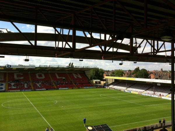 Lincoln City currently play their home games at The 12th Imp Sincil Bank Stadium. Photo: Tom Larken.