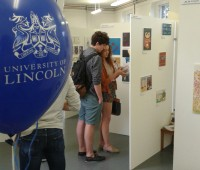 Members of the public look at the work made by university students