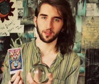 Dan with his tarot card and crystal ball. Photo: Dan Featherstone