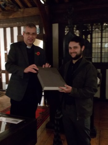 The Canon Chancellor at Lincoln Cathedral presents the facsimile to James Wakefield