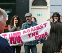 """war against the poor"" #ProtestLincs banner"