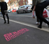 Shush campaign logo sprayed in pink upon the pavement on Carholme Road (Picture: Gregor Smith)