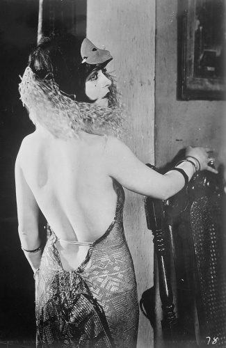 1920s actress Clara Bow wears a backless dress
