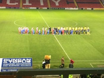 The teams came out to an energetic atmosphere at Sincil Bank. (Photo: Ryan Petterson)
