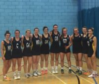 The University of Lincoln women's first team celebrate their first win with a team photo.