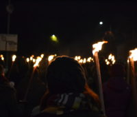 A participant in the procession carrying her torch. Photo: Liam O'Dell