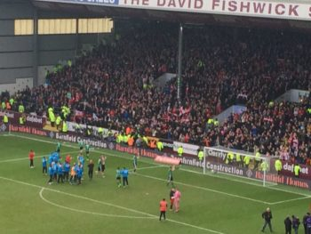 Imps fans celebrate after seeing their side knock out Premier League side Burnley