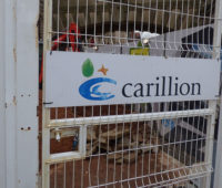 Carillion logo text on a metal gate.